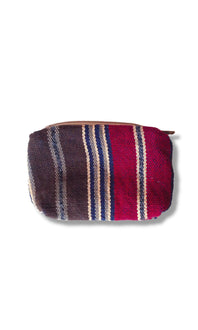 Backstrap loom woven coin purse with ikat flair in center panel. Brown, white, red and blue with ykk zipper. Guatemalan textile. back side.