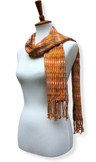Handwoven Pumpkin Mash Cotton scarf with twisted thread accents. Backstrap loom made Guatemalan textile, simple wrap view