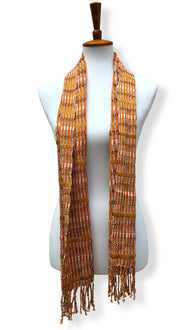 Handwoven Pumpkin Mash Cotton scarf with twisted thread accents. Backstrap loom made Guatemalan textile, 2 long tails view