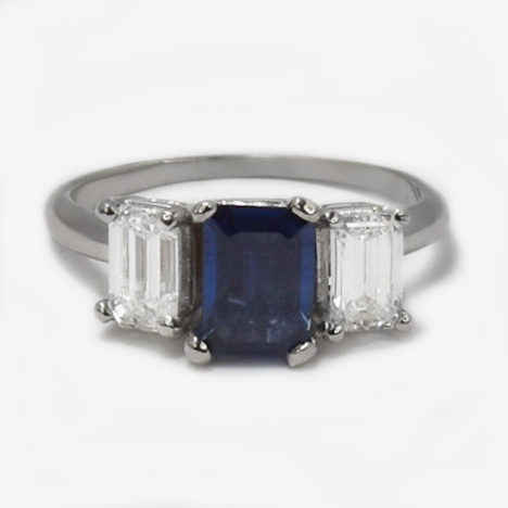 Vintage Platinum Sapphire and 1 carat Baguette Diamond Three Stone Ring.