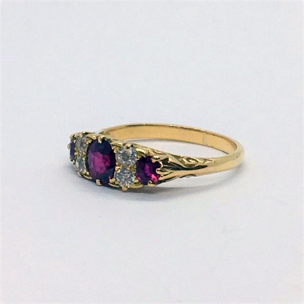 Ruby and Diamond Three Stone Yellow Gold Ring