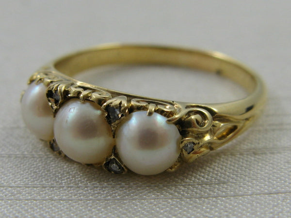Three Stone Cultured Pearl and Diamond Ring.