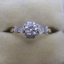 Diamond Solitaire Ring with Ornate Shoulders