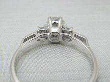 Art Deco Platinum Diamond Solitaire Ring with Step Down Shoulders