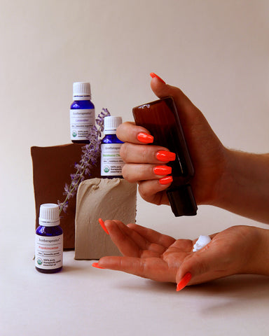 Essential Oils for Skin care - Woman holding bottle