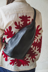 Single strap Fanny pack or backpack in black leather. Fehn crossbody hip pack.