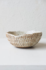 SMALL CARVED BOWL IN SPOTTY WHITE