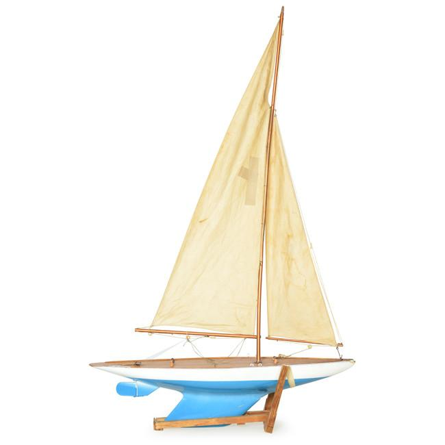 Blue and Cream Model Sailboat