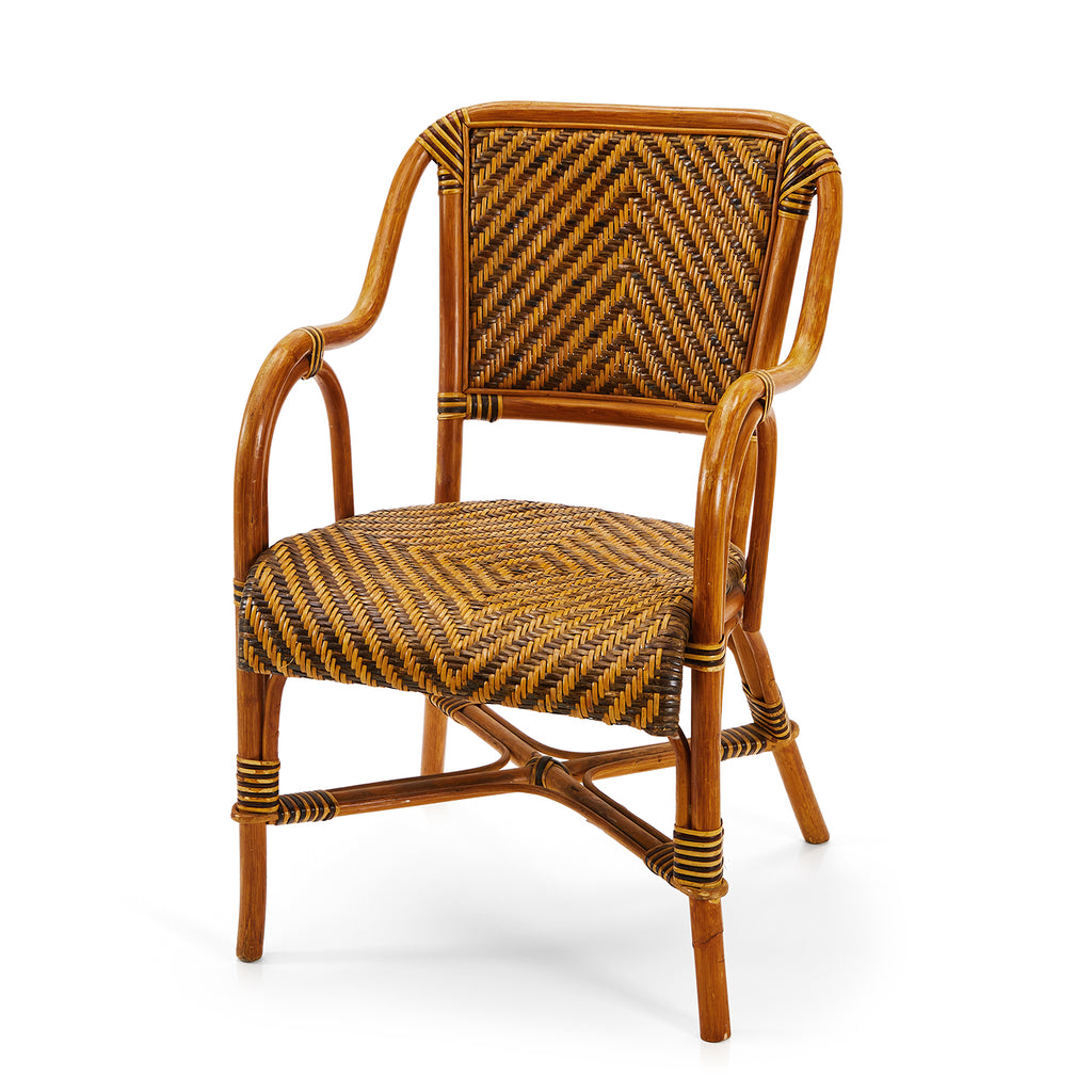 Black and Straw Patterned Rattan Chair