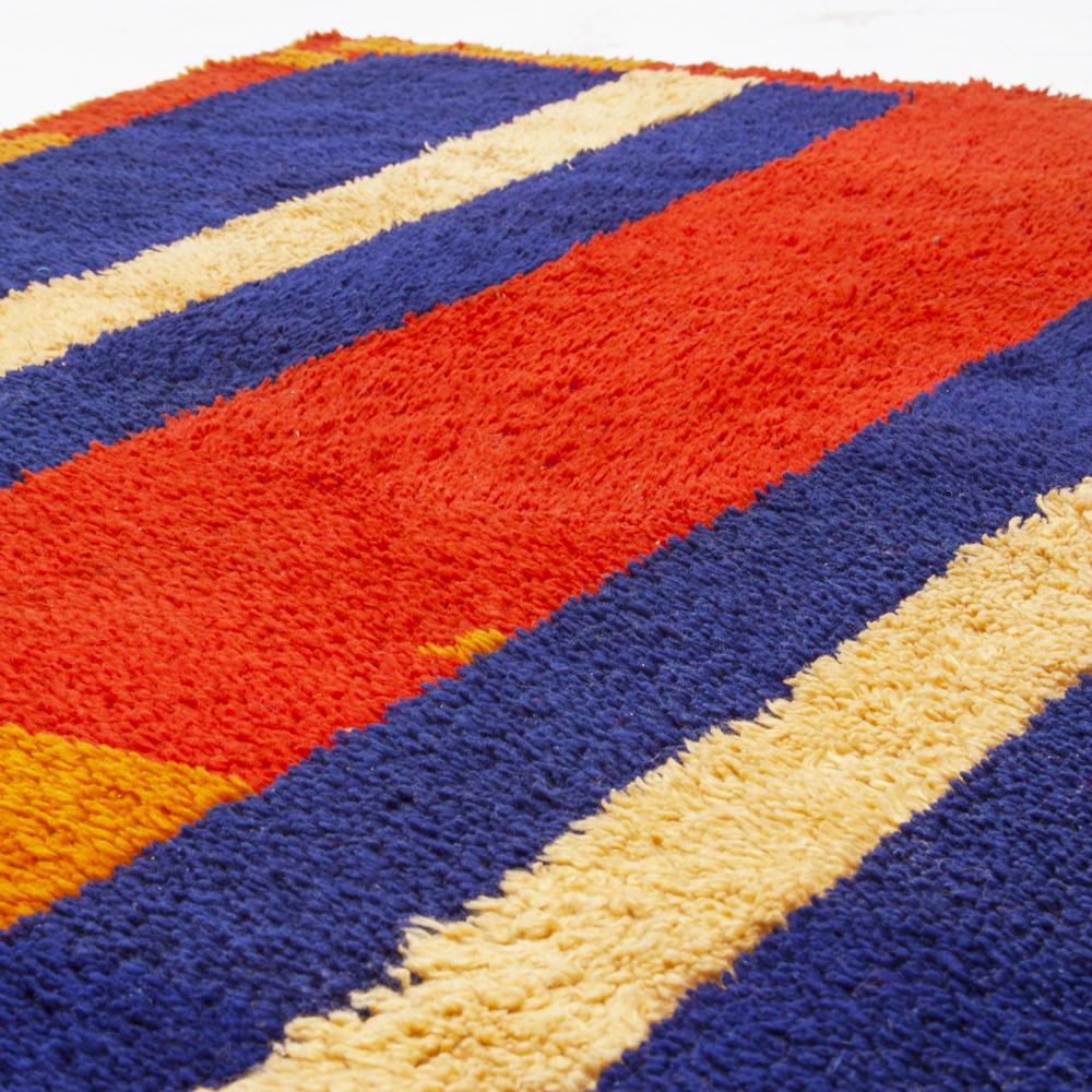 Red, Yellow, Blue Striped Rug