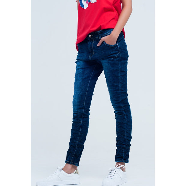 Dark blue boyfriend jeans. There is all over wrinkle and faded effect which gives a very chic and edgy look. The relaxed fit also makes it very appropriate for everyday wear. Comfortable material.
