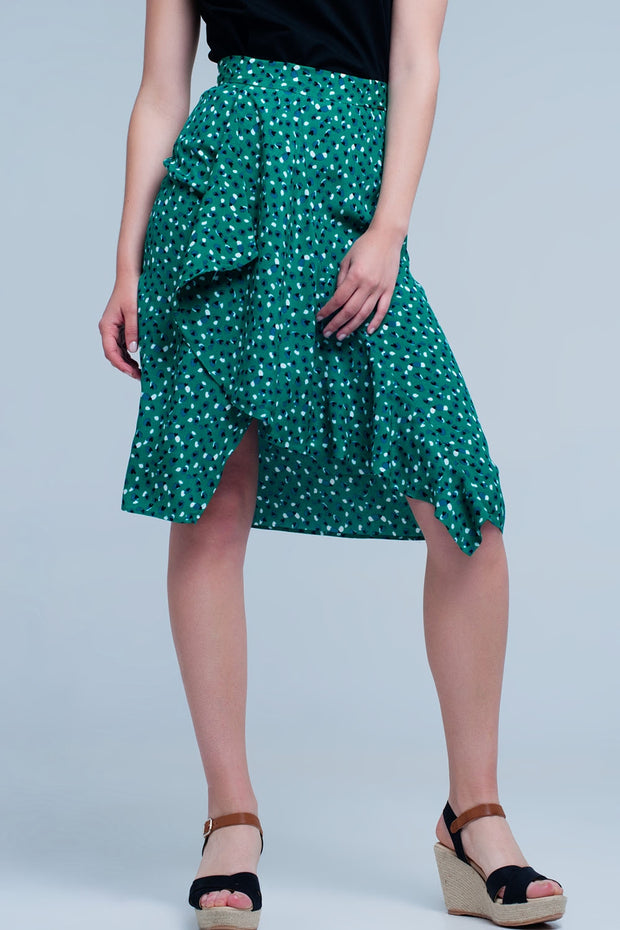 Green skirt with flower print made from airy polyester. This medio skirt has a small split at the front.