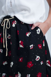 Buy Black Mini Skirt with Floral Pattern