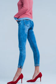 Medium wash skinny jeans with leopard print