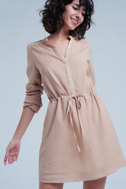 Beige dress made from comfortable polyester. This dress has long sleeves and a ribbon at the waist, to make the dress tighter.