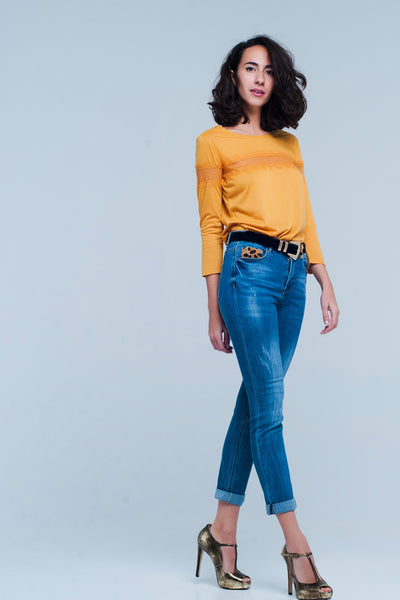 Skinny blue jeans of comfortable stretchy cotton. Standard five functional pockets with leopard printed details on it and can be closed by zipper and button.