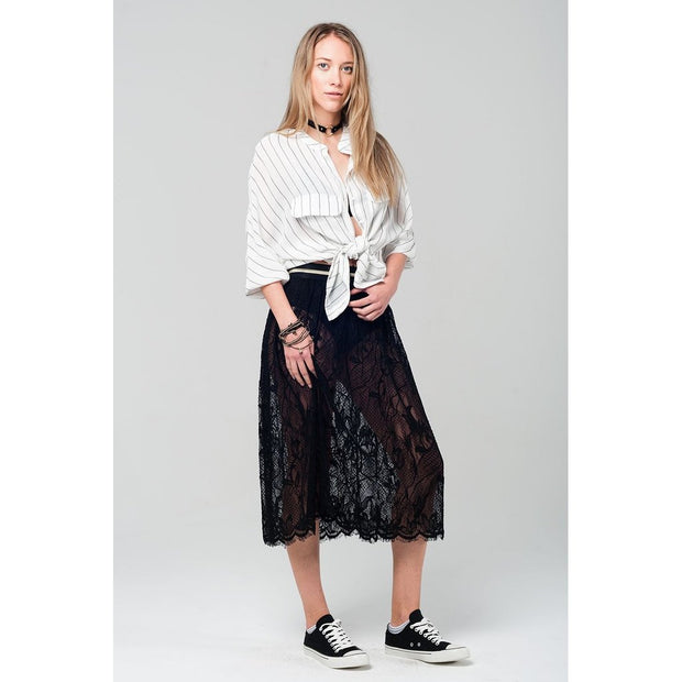 Midi see through lace black skirt with an elastic waistband in black and metallic gold detail.