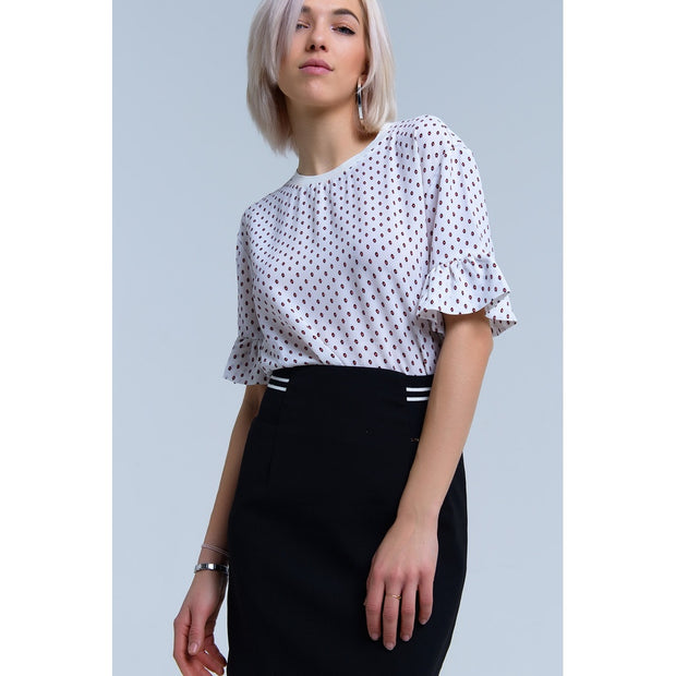White polka dot blouse with 3/4 sleeves and ruffle detail.