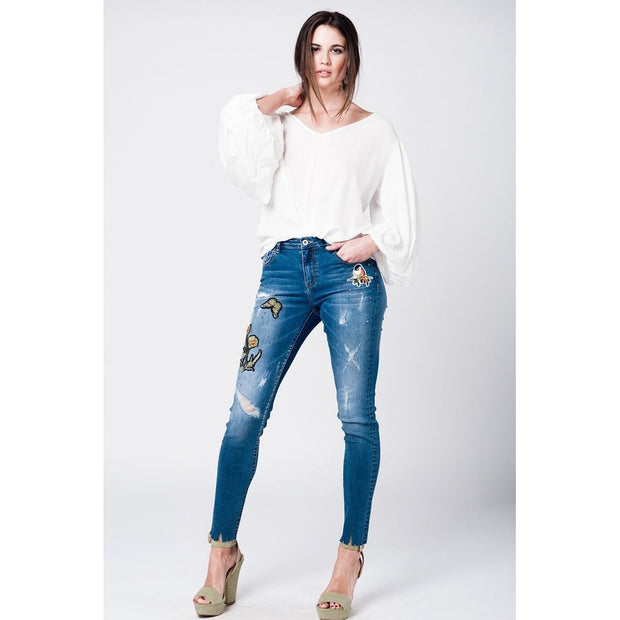 Buy Mid wash high waist standard rip denim trouser. Thick fabric with stepped hem, patches and floral embroidery available in different sizes. Free Shipping on orders over 50$