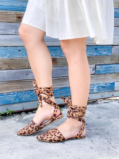 Lace up cheetah print flats
