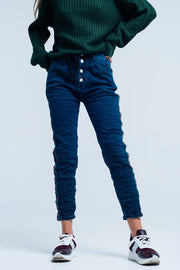 Blue Baggy Jeans with multi-colored side striped. Can be closed by a drawstring and four buttons. The pants is oversized by the pockets and can therefore be seen as a boyfriend jeans too.