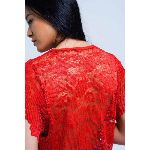 Red t-shirt with soft lace back. Sleeves with ruffles and lace. Round neck. Soft and fine front fabric.