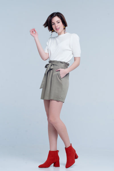 Khaki mini skirt made of soft and slightly stretchy viscose. This skirt has a bow and ruches around the waist.