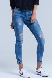 Buy Skinny jeans in medium wash with ripped details. Folded bottom available in different sizes. Free Shipping on orders over 50$.