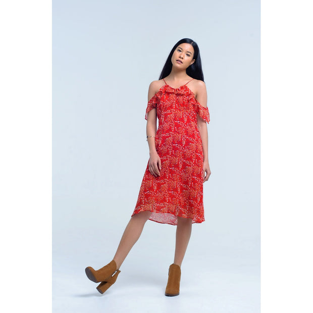 Red dress with printed flowers. Slim strap and with ruffles on the shoulders. Back opening and round neck. Fresh and fluffy fabric.
