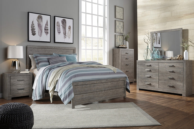 Ashley Culverbach E King Panel Bed Weathered Driftwood in Gray - The Furniture Space.