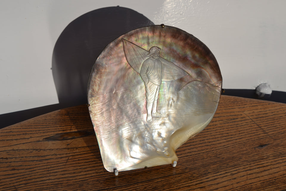 Tahitian Black Ocean Pearl oyster shell with French fisherman relief carving