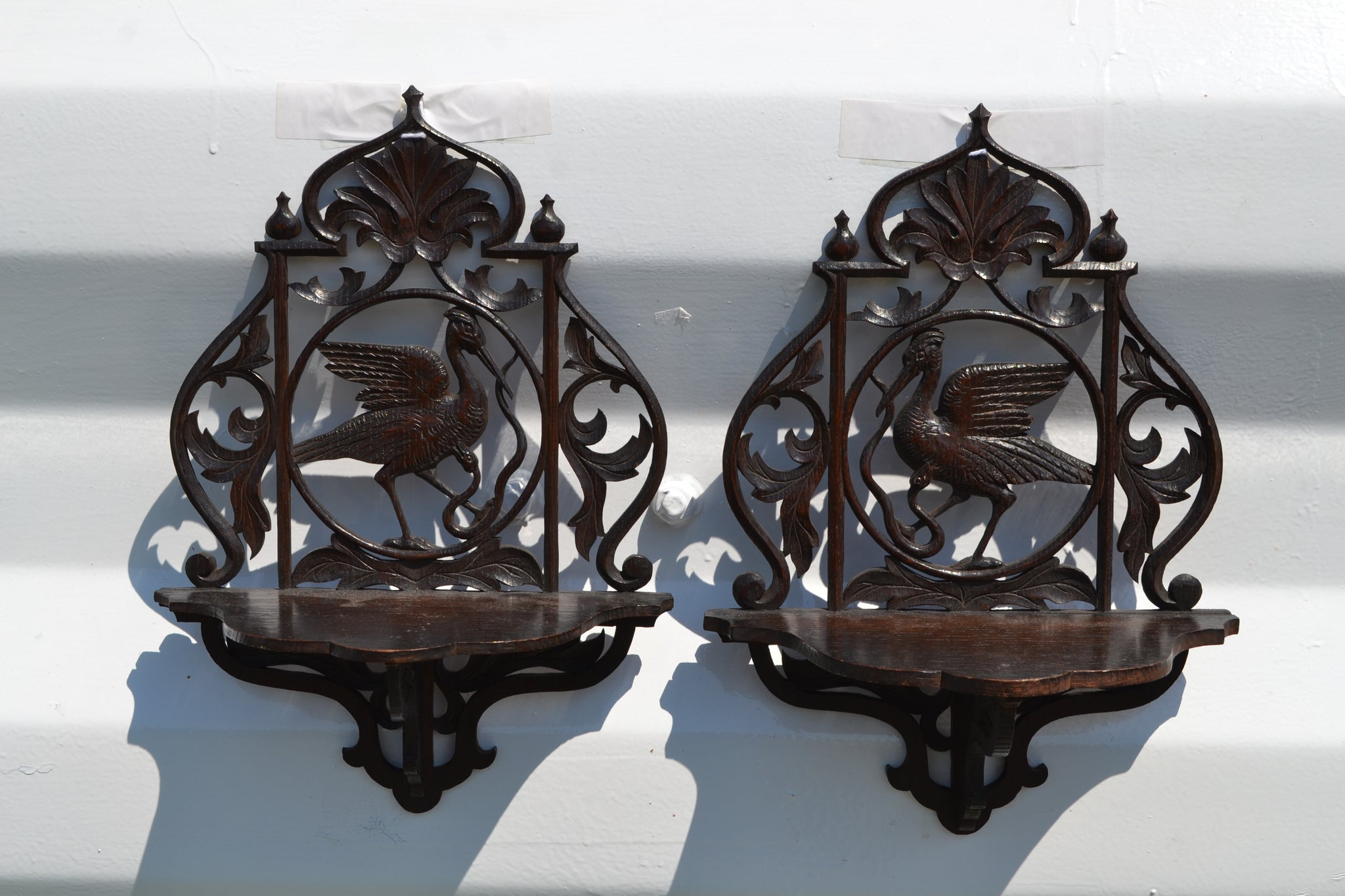 A pair of Victorian carved Heron bracket shelves