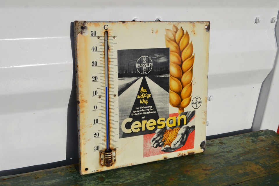 A Ceresan fertilizer enamel thermometer sign