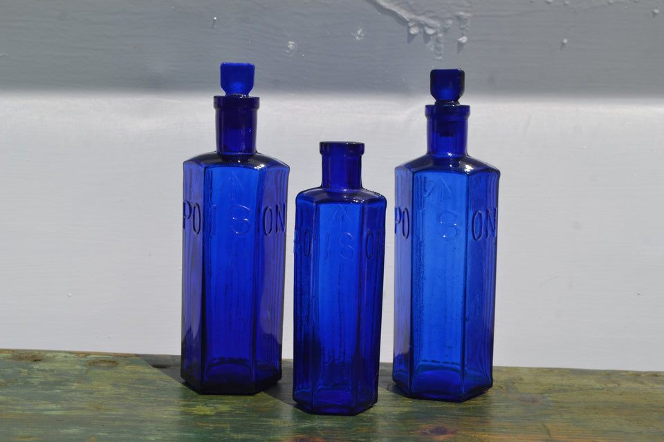 A Trio of Cobalt Admiralty Poison Bottles - £100 Large ea, £60 small