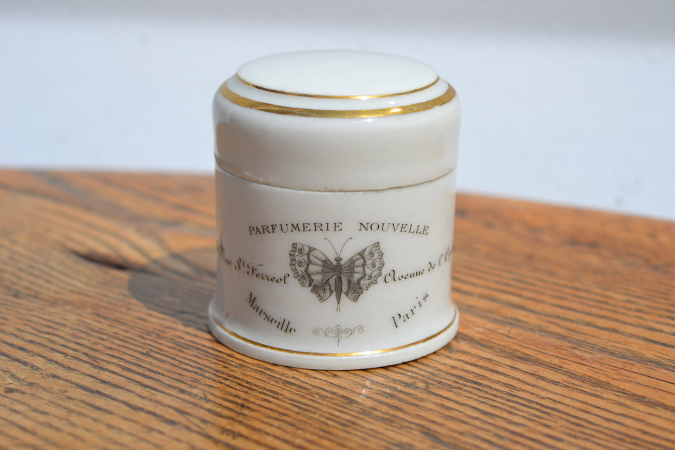 A French Belle Époque cosmetic pot with pictorial butterfly print