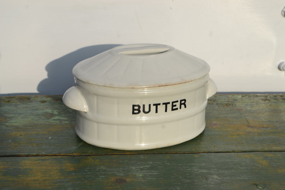 A large white ironstone lidded butter pot