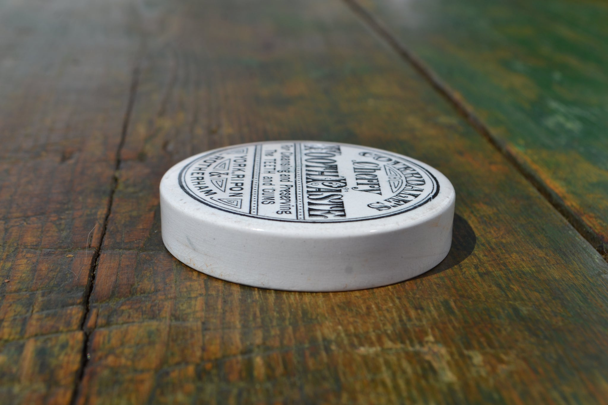 A Coverdale's Cherry Tooth paste pot lid