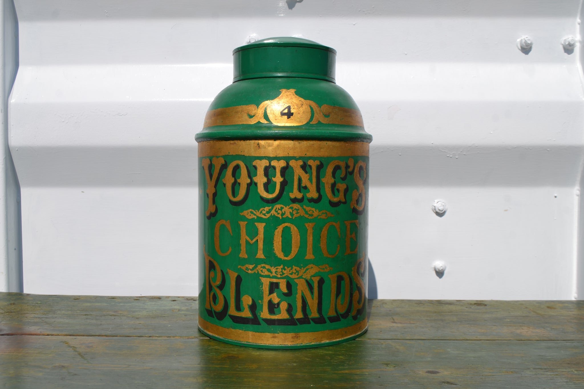 A vintage Tole Tea Tin