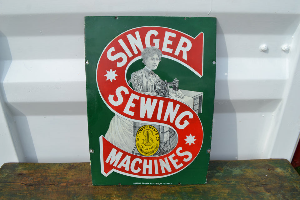 A Singer sewing machines enamel sign