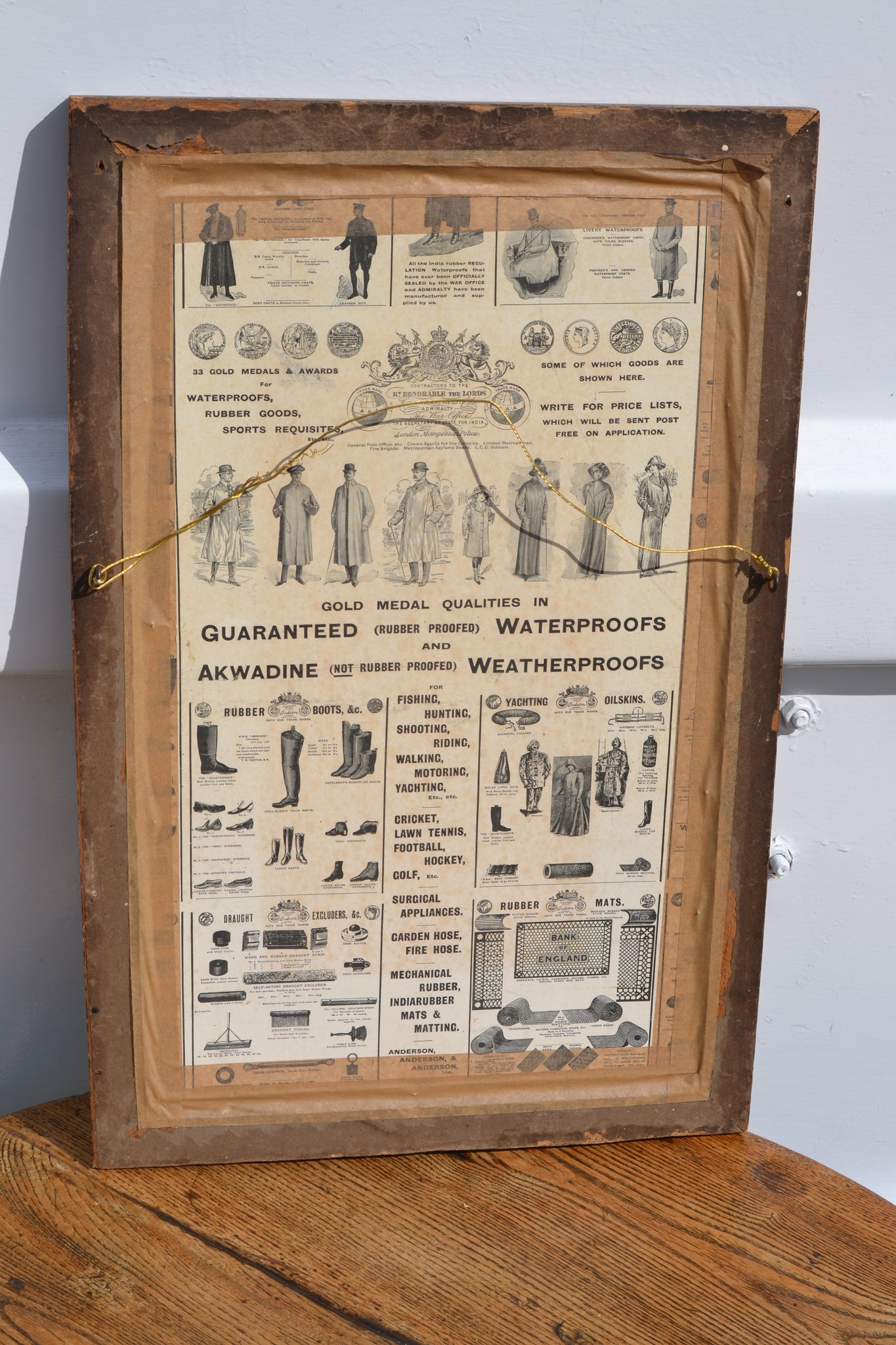 A framed Anderson Overcoats showcard advertisement