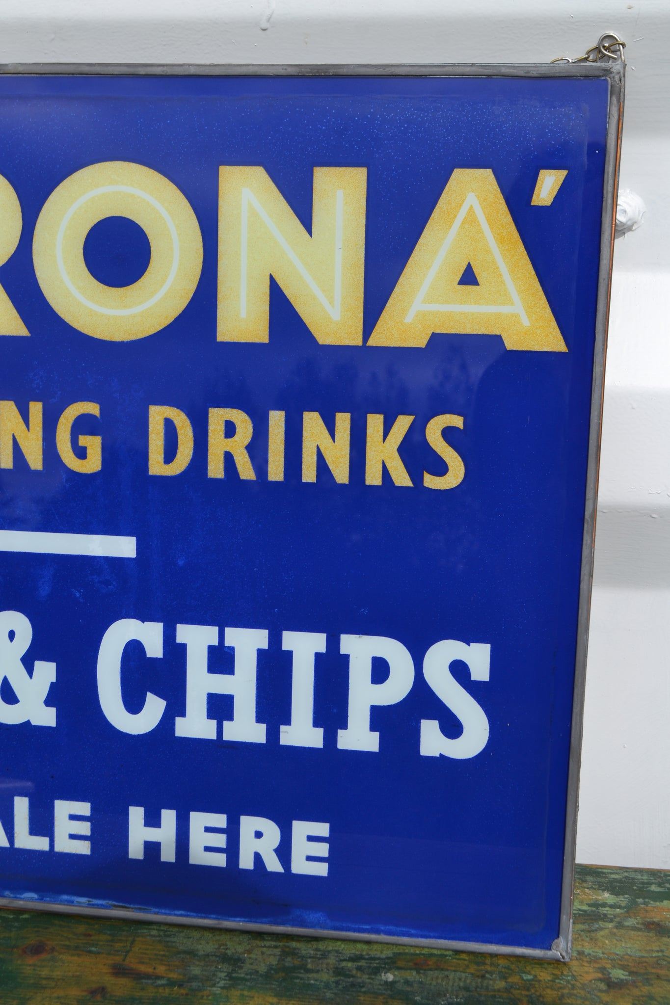 A framed Corona 'Fish & Chips' glass panel