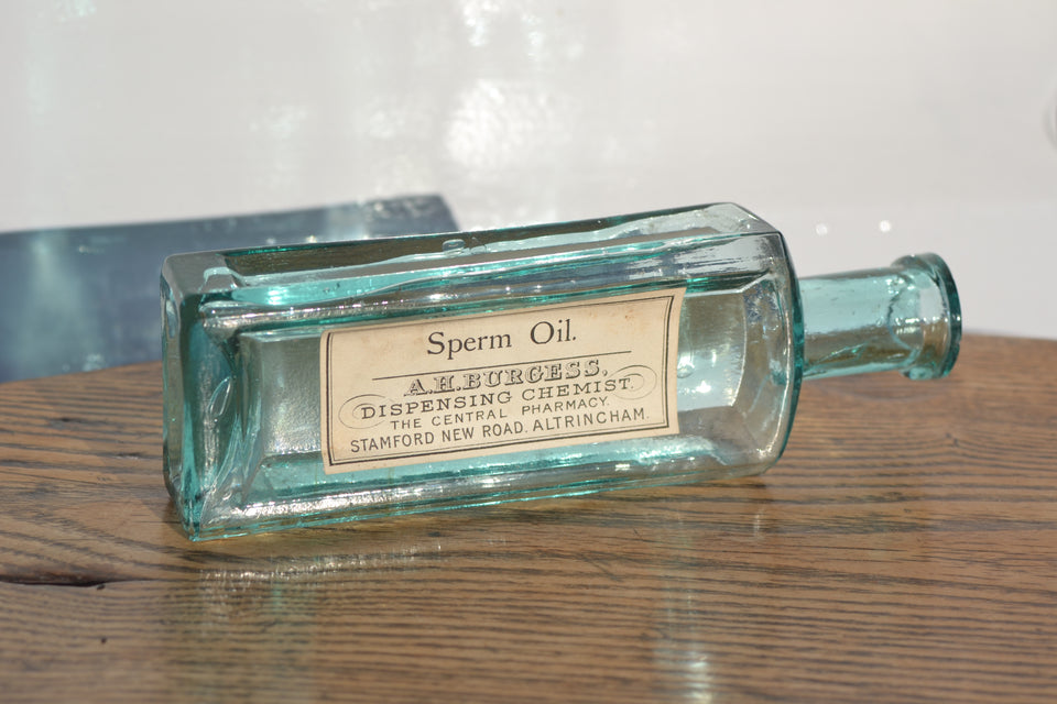 An aqua blue Sperm oil chemist bottle