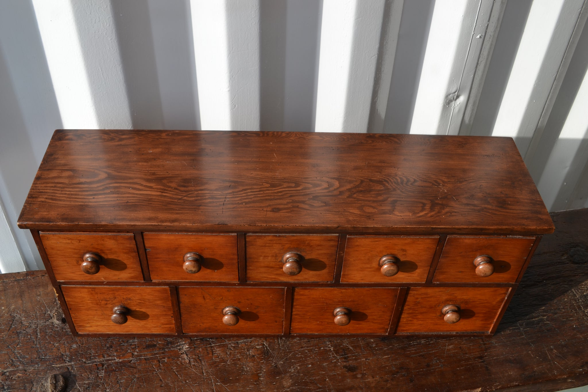A small bank of cedar apothecary drawers
