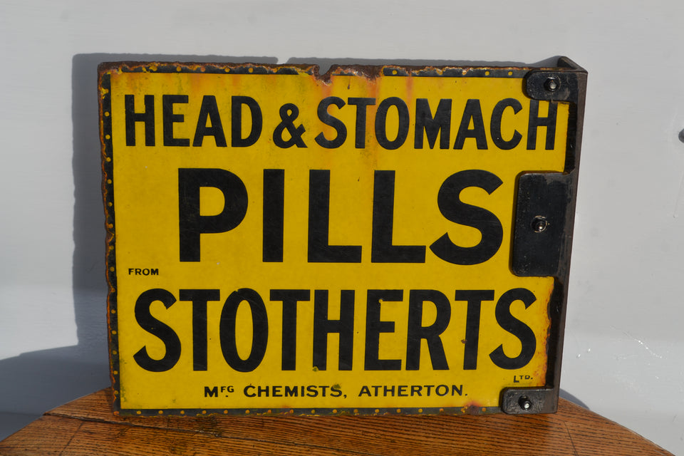 A Stotherts Head & Stomach pills enamel sign