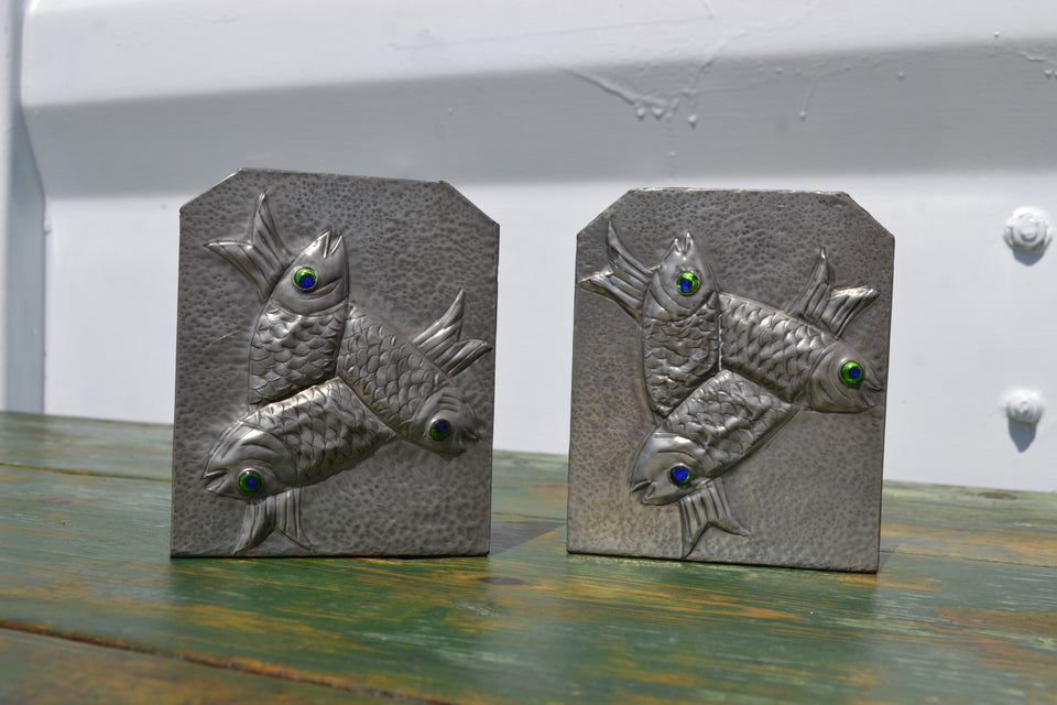 A pair of Art's & Crafts fish bookends
