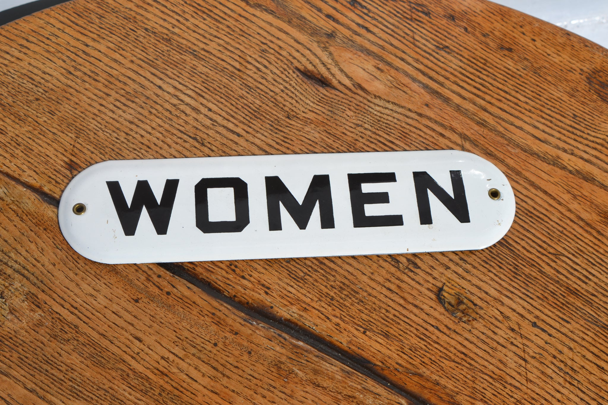 A 'Women' enamel door sign