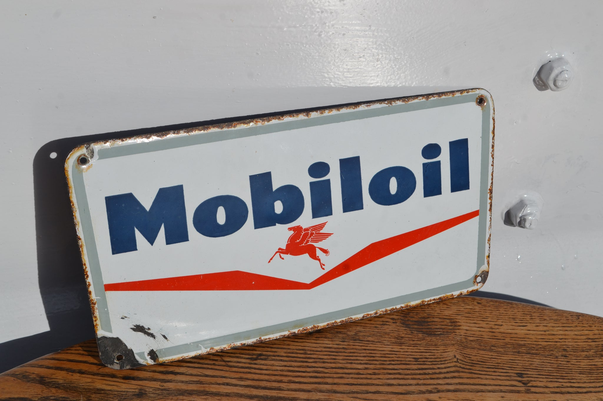 A small Mobiloil Enamel sign