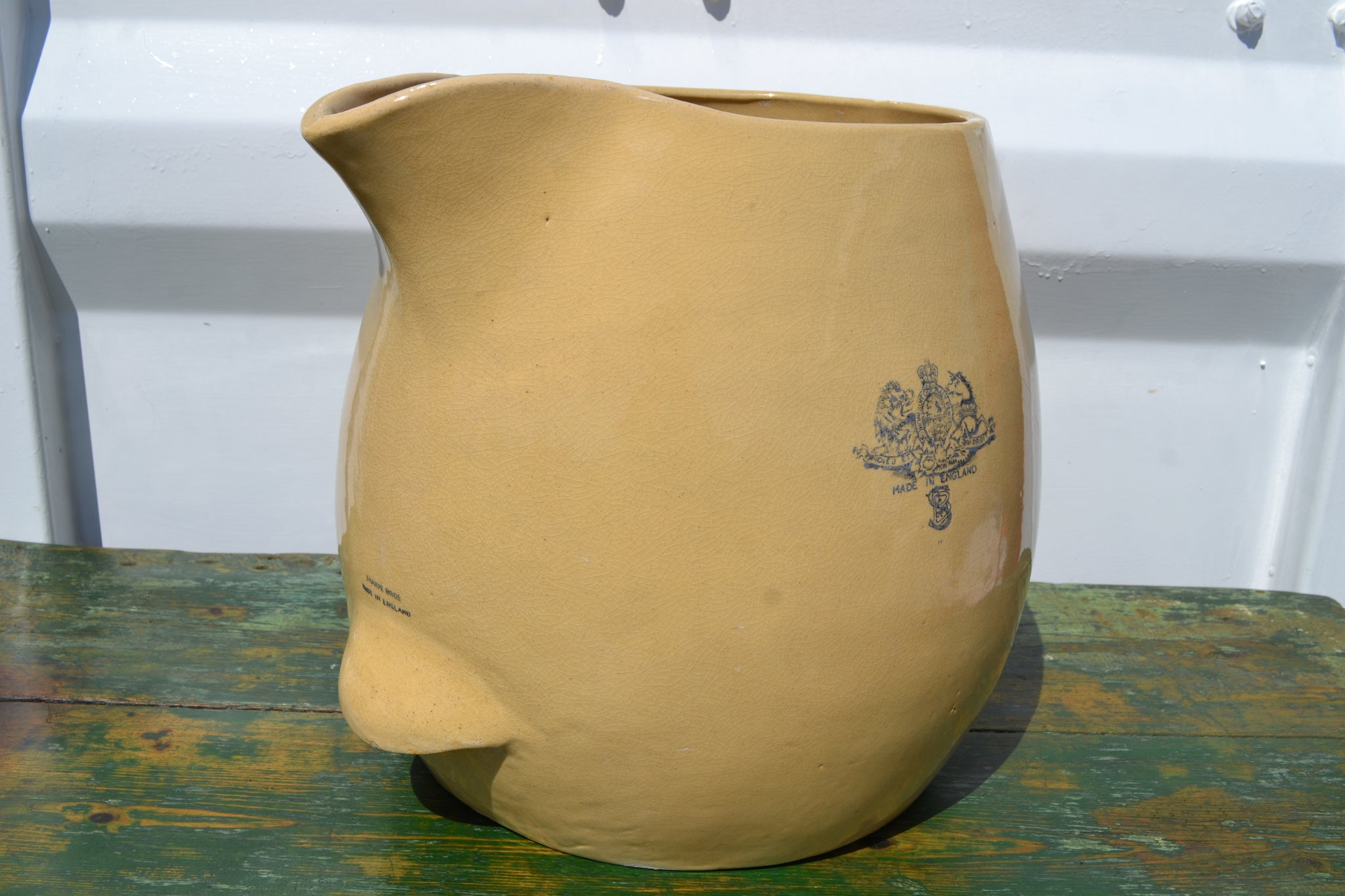 A GIANT Sharpe Bro's pottery Jug
