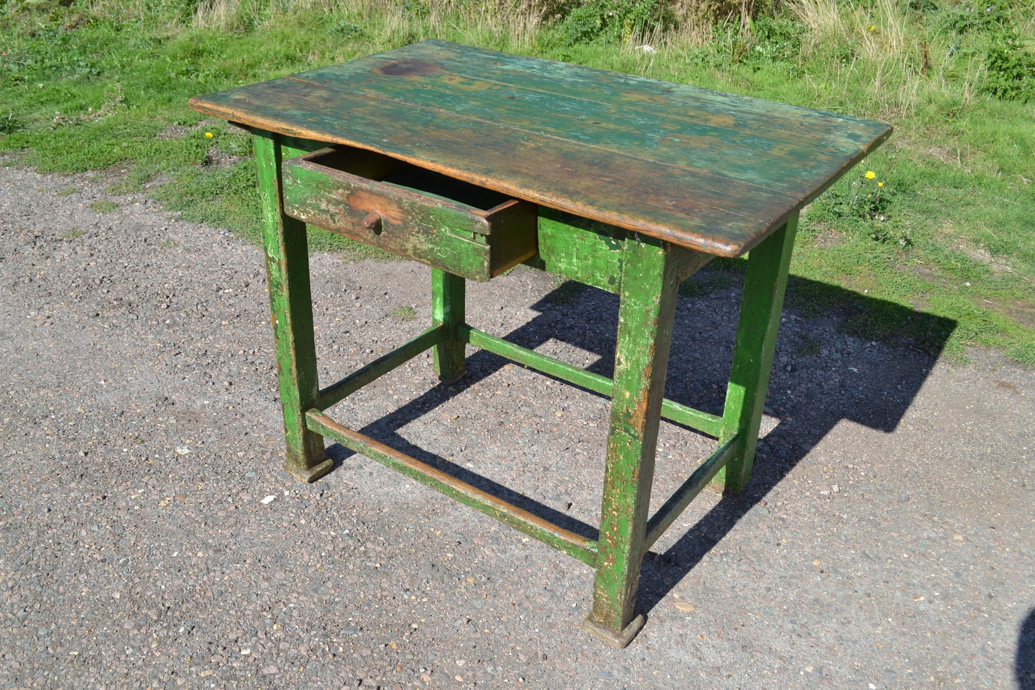 A rustic painted work table