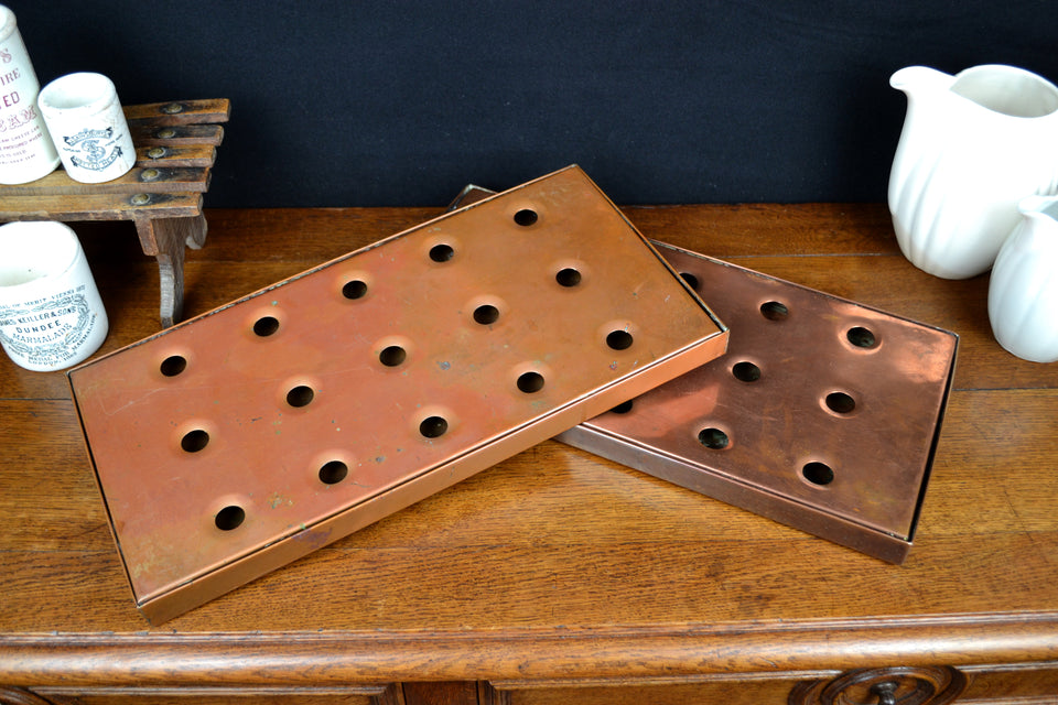 Two vintage copper bar drip trays